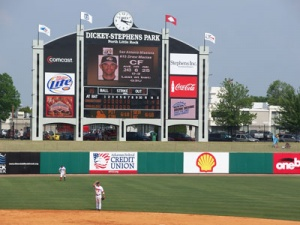 The scoreboard at Dickey-Stephens. It cost 1.2 million dollars, and according to Pete Laven (General Manager), it's one of the biggest scoreboards with one of the biggest LED video screens in minor league baseball. It was designed to look like the scoreboard in Ray Winder Field. Photo courtesy of Nathan Smith and Allison Hogue.